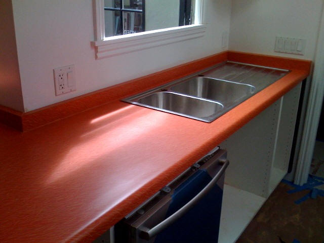 We Specialize In Doing Custom Work Including Under Mount Solid Surface  Sinks Mounted Into Laminate Countertops.